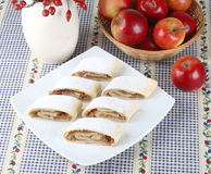Still life with apple roll (strudel). And apples Stock Photography