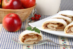 Still life with apple roll (strudel). Apple roll-strudel and fresh apples Stock Images