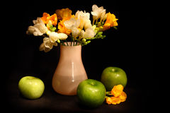 Still life with apples and flowers Royalty Free Stock Photos