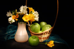 Still life with apples and flowers Stock Photo