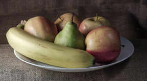 Still life with apples. Fruit plate on the table on a background of linen fabric Stock Photo