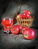 Still life with apples and a glass of wine. In ancient style Royalty Free Stock Image