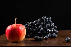 Still life. Of apples and grapes Stock Image