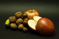 Still life with apples, walnuts and bananas Stock Images