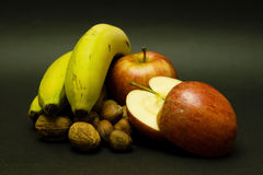 Still life with apples, walnuts and bananas Royalty Free Stock Photo