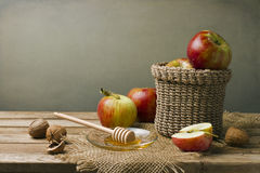 Still life with apples, walnuts and honey Stock Photos