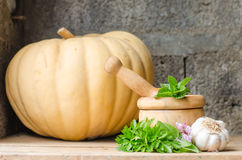 Still life of aromatic herbs. Rustic still life of aromatic herbs with a wooden mortar Royalty Free Stock Photo