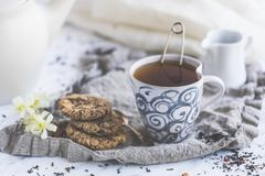 Chocolate chip cookies and tea royalty free stock image
