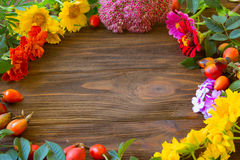 Still Life Arrangement on Rustic Wood Board Table Background wit. H room or space for copy, text, your words. autumn flower Still Life Stock Photo