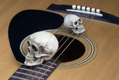 Still life art photography concept with skull and guitar Stock Photography
