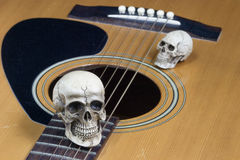 Still life art photography concept with skull and guitar Stock Image