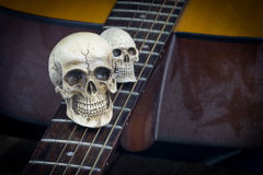 Still life art photography concept with skull and guitar Royalty Free Stock Photo