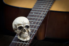Still life art photography concept with skull and guitar Stock Photo