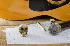 Still life art photography concept with skull and guitar Royalty Free Stock Image