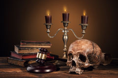 Still life art photography on human skull skeleton. With blank scroll and books. Concept of judge verdict Stock Images
