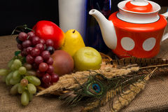 Still life with artificial fruit. And ceramic kettle Royalty Free Stock Images