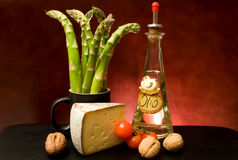 Still Life With Asparagus, Cheese And Olive Oil royalty free stock photography