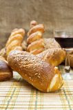 Still life assortment of bread with a glass of red wine. Stock Photo