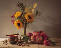 Still Life Autumn Bouquet. Autumn Bouquet and all the colors of autumn in it with apples, honey and nuts royalty free stock photo