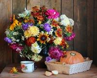 Still life with autumn bouquet of garden flowers Stock Photos