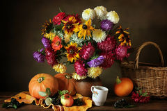 Still life with autumn flowers and pumpkins Royalty Free Stock Photos