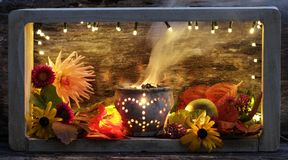 Still life in autumn with incense. Still life in autumn with flowers Stock Photography