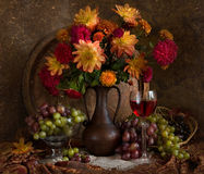 Still life with autumn flowers and wine royalty free stock images