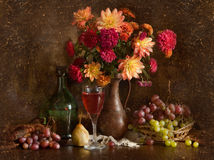 Still life with autumn flowers and wine royalty free stock image