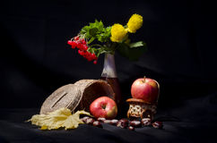 Still life with autumn fruits and flowers Stock Photo
