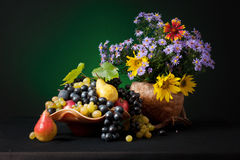 A still life. An autumn still life with fruits and flowers Royalty Free Stock Photo
