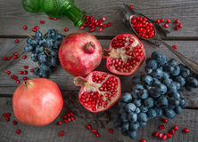 Still life of autumn fruits, pomegranates, grapes, apples. Stock Image