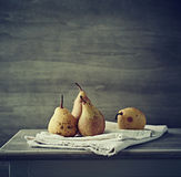 Still life with autumn pears on linen Stock Photos
