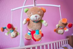 Baby musical animal mobile focusing, Selective focus. royalty free stock images