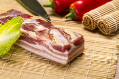 Still life with bacon, salad, red bell pepper Royalty Free Stock Photos