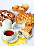 Still life with baking pies and tee cup and pot. Royalty Free Stock Photography