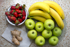 Still life of bananas, apples, strawberries. Royalty Free Stock Photo