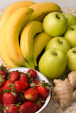 Still life of bananas, apples, strawberries. Royalty Free Stock Images