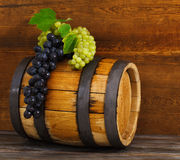 Still life with barrel decorated red and white grapes Royalty Free Stock Photography