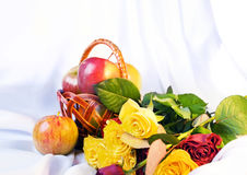 Still life with the basket of apples and roses royalty free stock images