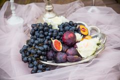 Still life: basket with grapes, figs and plums. Still life:a basket with grapes, figs and plums Stock Photos