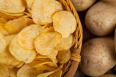 Still life from a basket with potato chips Stock Photo