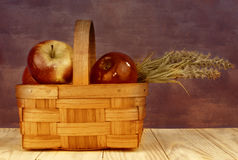 Still life basket of red apples and flowers Royalty Free Stock Photos