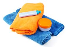 Still-life with bath towel and shampoo on a white Stock Images