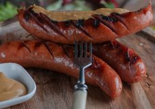 Still life of Bavarian sausages grilled. stock photo
