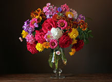 Still life with a beautiful bouquet of cultivated flowers Stock Image