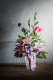 Still life with a beautiful bunch of Flowers with cobweb on wood Stock Image