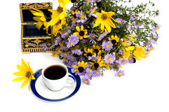 Still life beautiful casket, coffee and bouquet of flowers Stock Photography