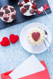 Still-life of beautiful cupcakes and romantic envelope Stock Photo