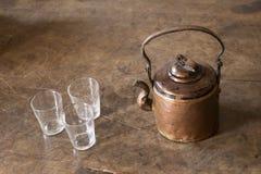 Vintage brass tea pot with empty glasses Stock Image