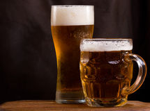 Still life with  beer. Still life with mug and glass of beer Stock Photos